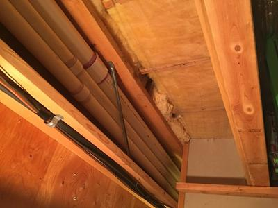 4-inch PVC pipe ran through basement rafters to garage next to existing furance vents