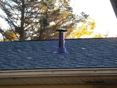 Vent through roof with storm cap