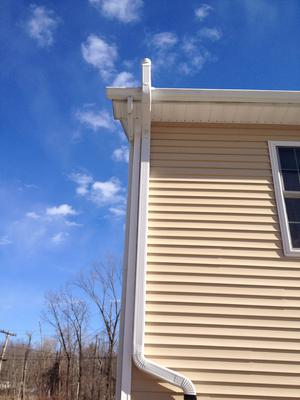 3x4 downspout installed next to roof gutter system.