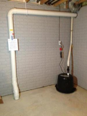 Basement floor penetration and covered pedestal sump pump